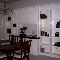 Custom built in wall unit in white lacquer
