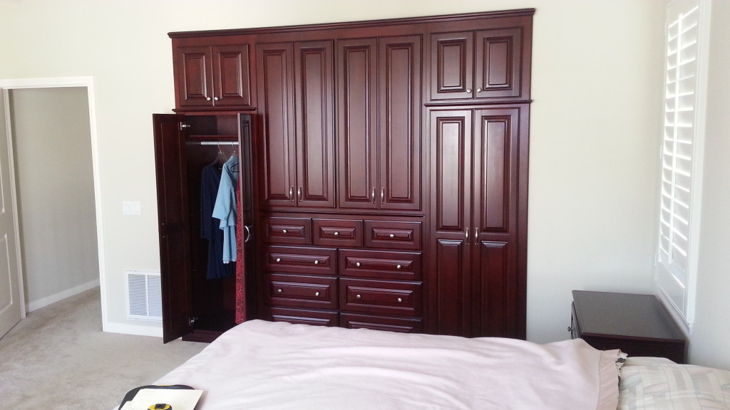 Master bedroom Alcove. Custom wardrobe in a cherry finish ...