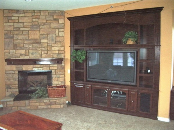 A built in a wall unit is a great alternative to entertainment center furniture