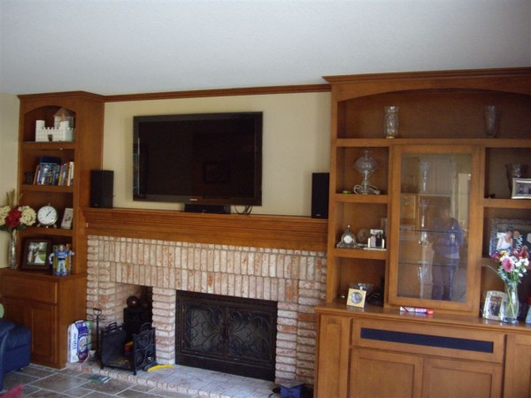 Custom built in shelves with mantel and tv over fireplace