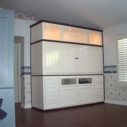 White lacquer wall unit is built into a wall