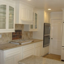 White lacquer kitchen cabinetry with glass doors