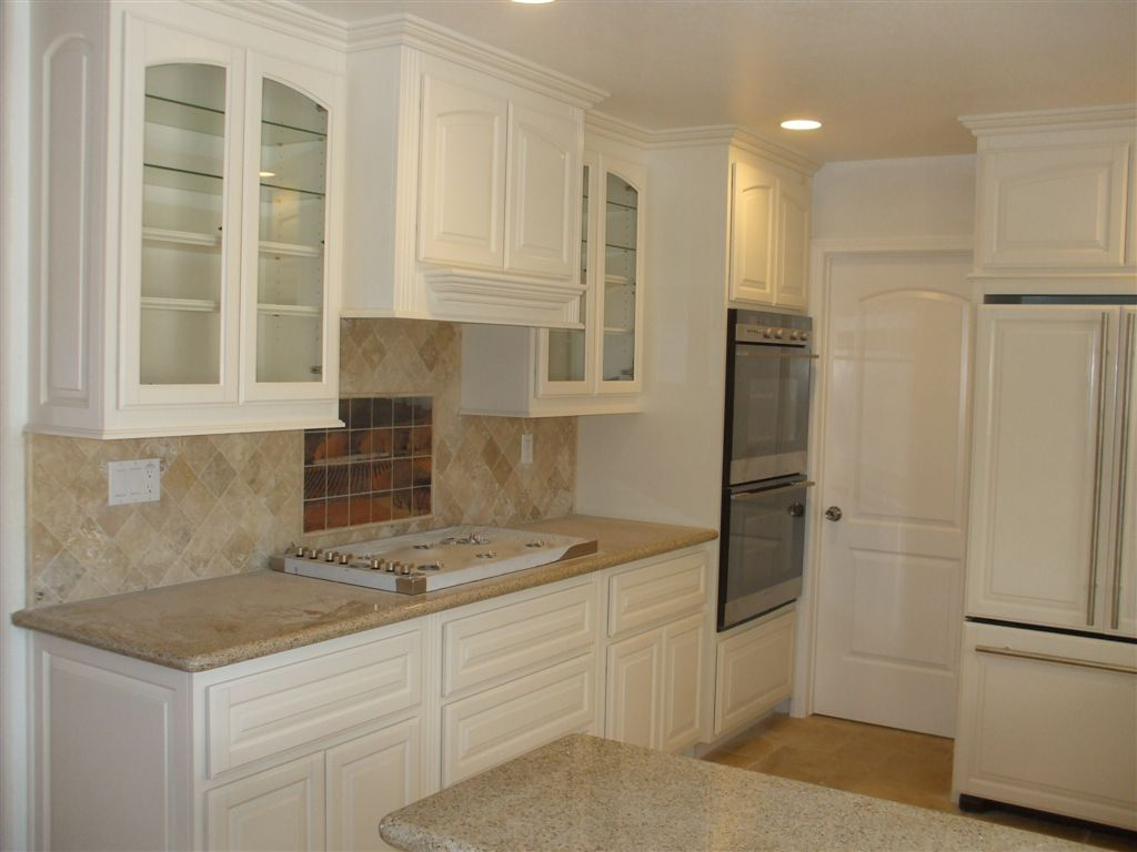 White Oak Kitchen Cabinets With Gloss White Accents By Kitchen Craft Cabinetry photo - 7