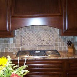 Kitchen cabinets with custom stove hood