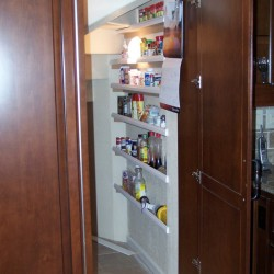 Secret door in kitchen leads to walk in pantry