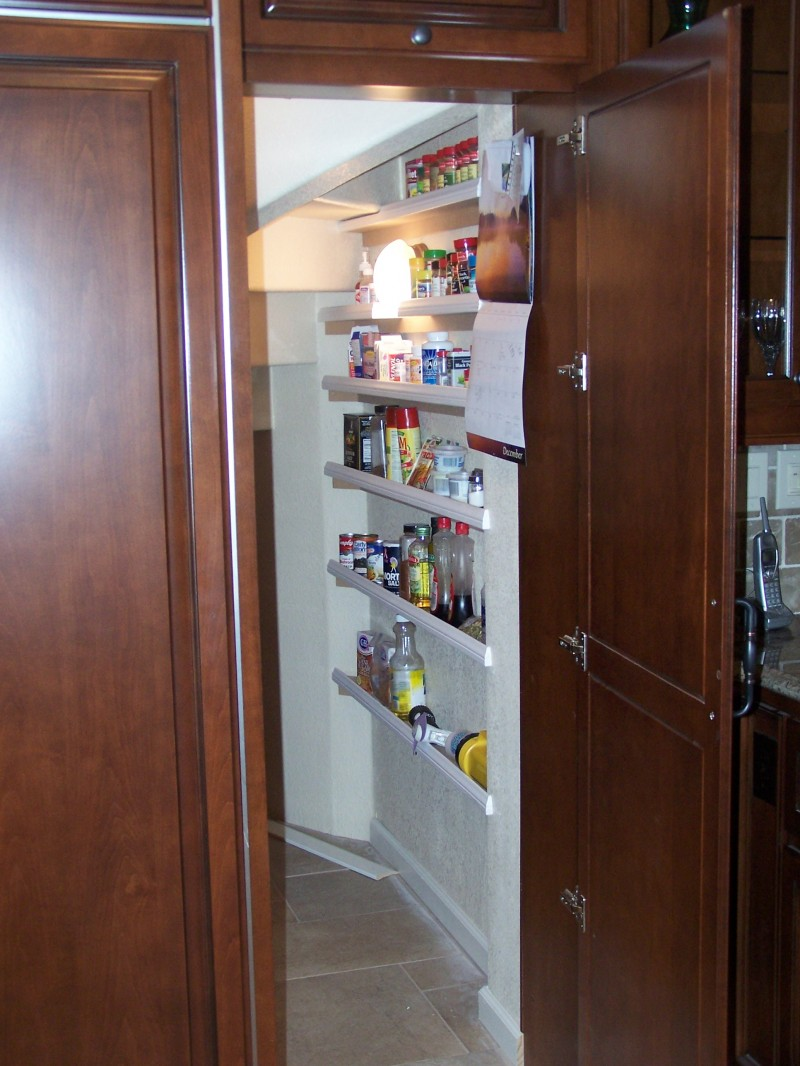Raised panel door in kitchen leads to walk in pantry c for House plans with walk in pantry