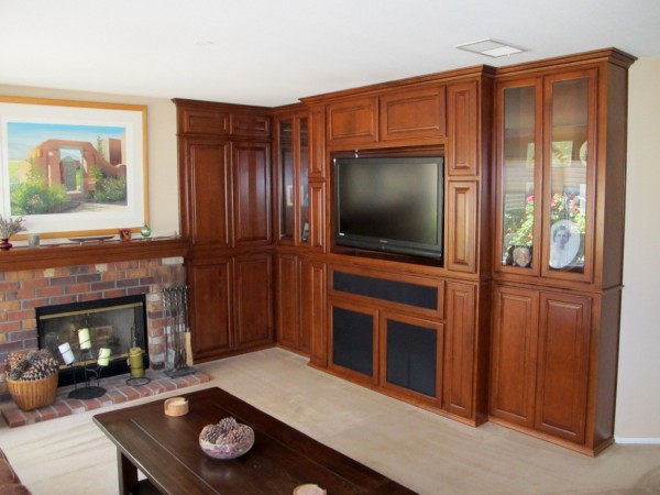 Custom wall unit with nutmeg cherry on Maple. Mantel compliments