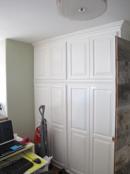 Storage cabinet with raised panel doors