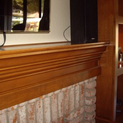 Wood fireplace mantel with built in bookshelves. Contact us today to quote a project like this for your home in San Diego or Orange County - even the Inland Empire.