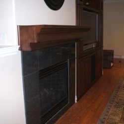 Wooden fireplace mantel and built in wall unit