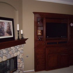 Wood fireplace mantel and built in wall unit