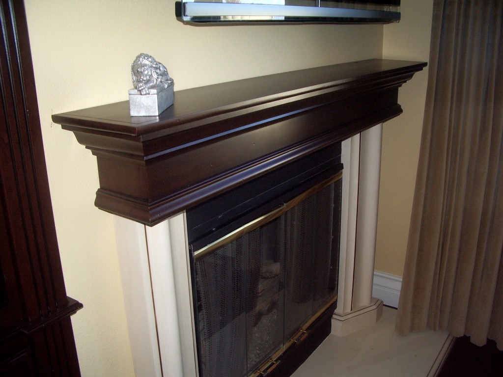 Amazing photo of Wood fireplace mantel matches built in book shelves. C & L Design  with #827549 color and 1024x768 pixels