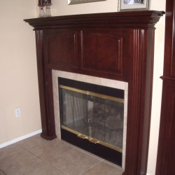 Beautiful fireplace mantel with fluted pillars.