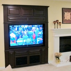 Beautiful Rancho Cucamonga home with stunning Maple entertainment center. 7X8 alcove entertainment center cabinet in Maple with dark fruitwood stain