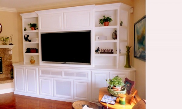 Entertainment center with angled corners and see through shelving in Carlsbad, CA.