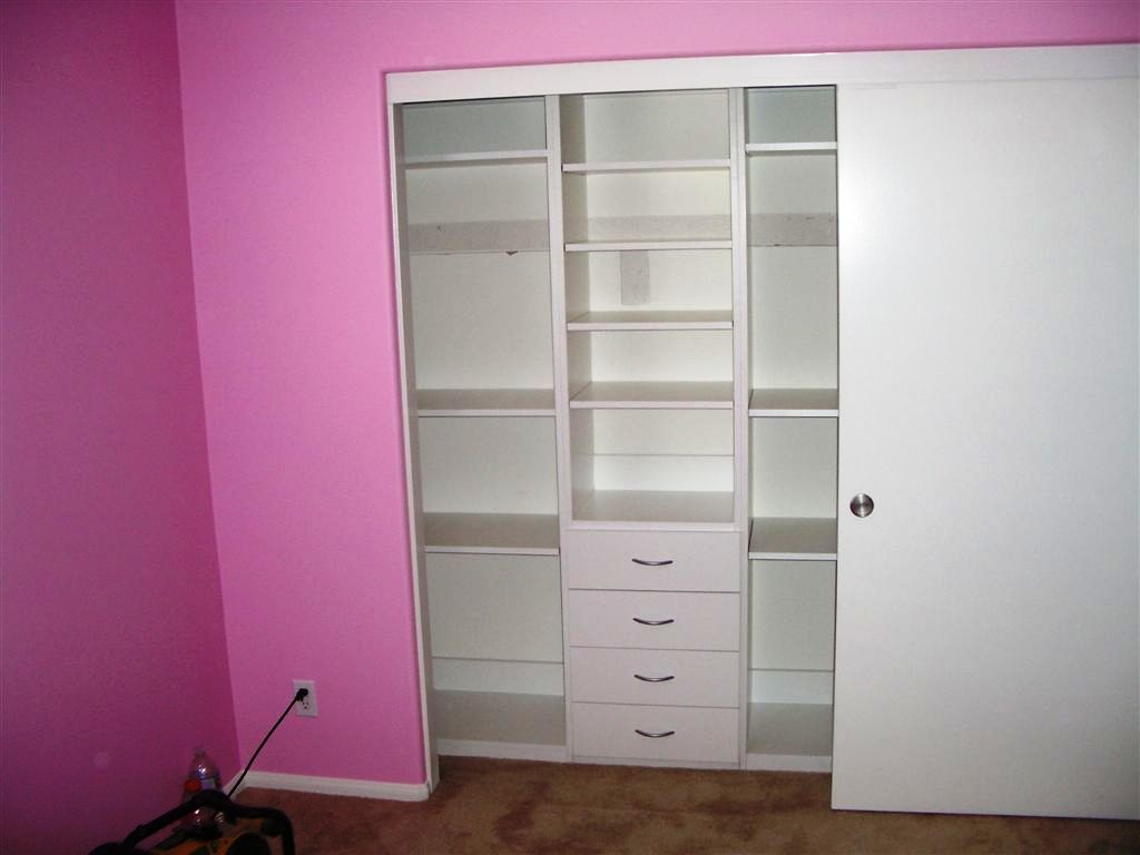 This Custom Closet System Has Built In Drawers And Shelves.