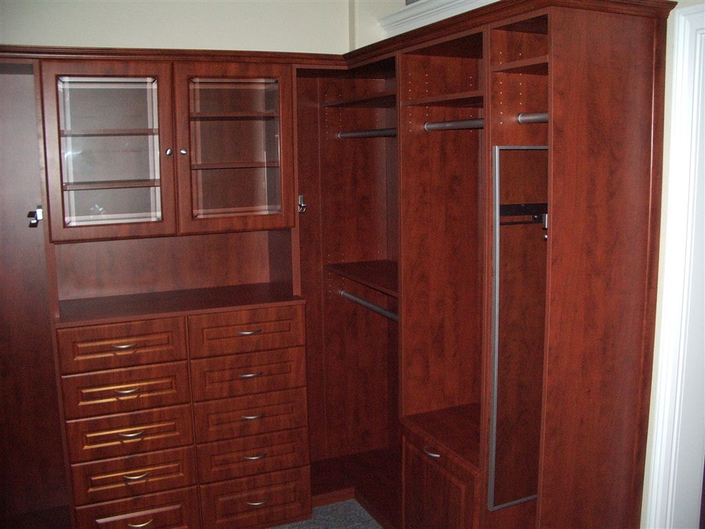 Built In Closet With Sliding Mirror, Built In Drawers And Sliding Belt Rack.