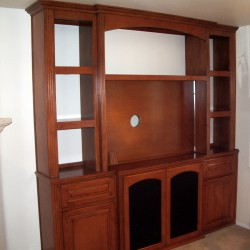 Custom built wall unit with no backing lets wall color show through.