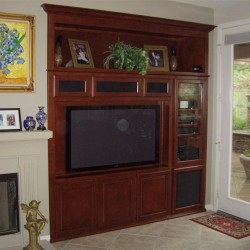Built in entertainment center with raised panel doors.