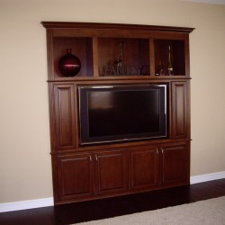 Built in wall unit with raised panel doors.