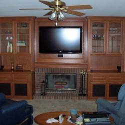 Built in wall unit and fireplace mantel.