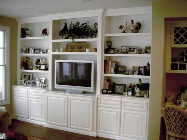 Built in white entertainment center cabinet