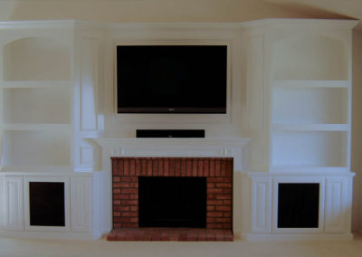 Custom white cabinets around fireplace