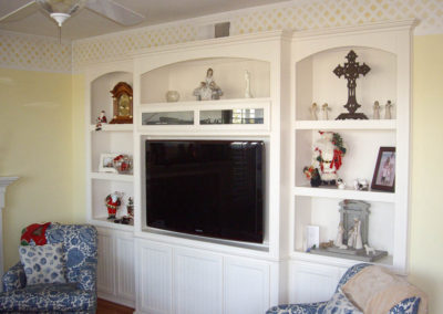White entertainment center with arches