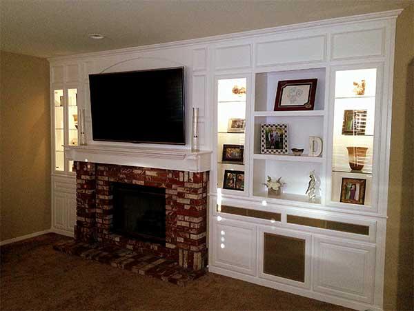 Custom entertainment center cabinets around fireplace