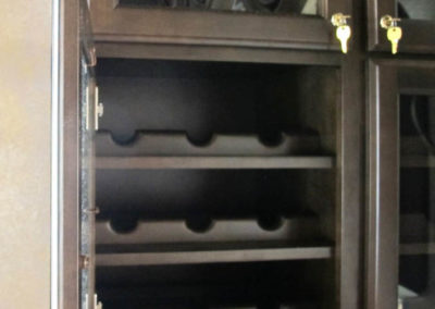 Locking wine storage cabinetry protects restaurant patrons personal wine.