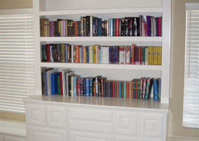 White built in cabinets with bookcases
