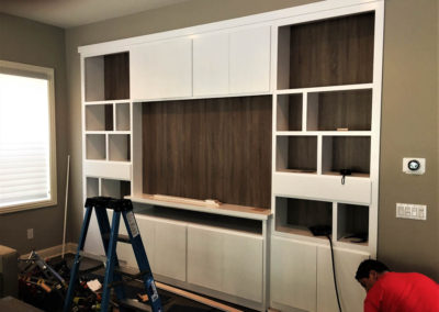 White cabinets with dark backing