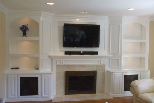 Anaheim Hills white lacquer entertainment center cabinet around fireplace