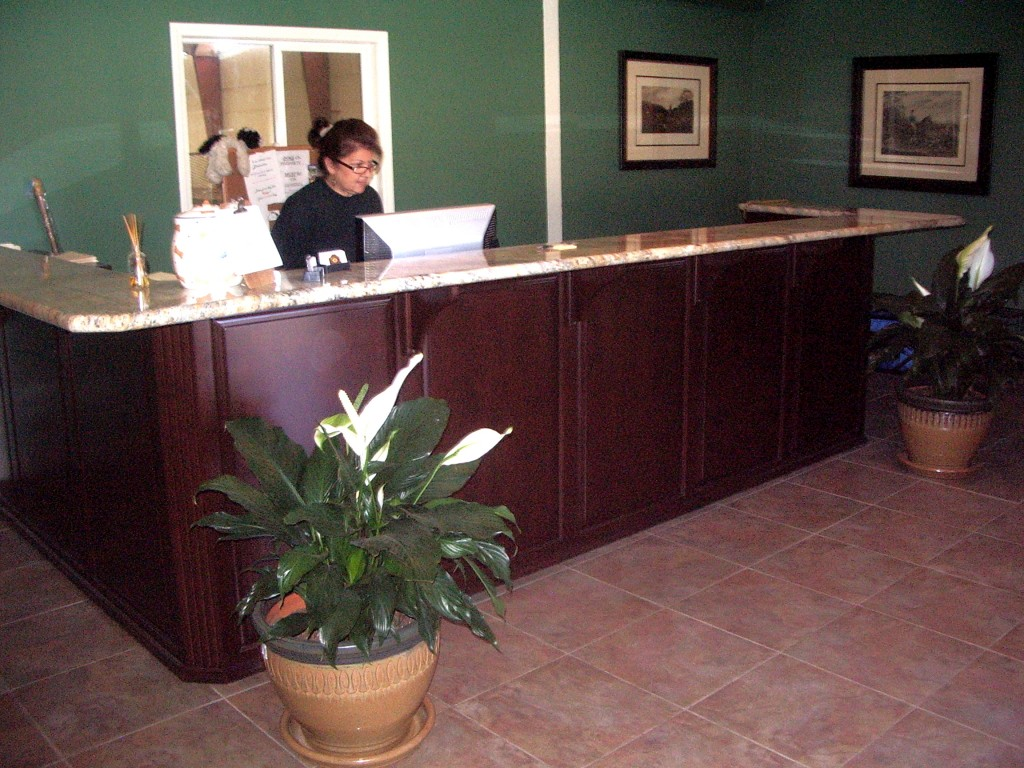 A 20 year old facelift was complete. Our work beautified Briarcliff's reception area