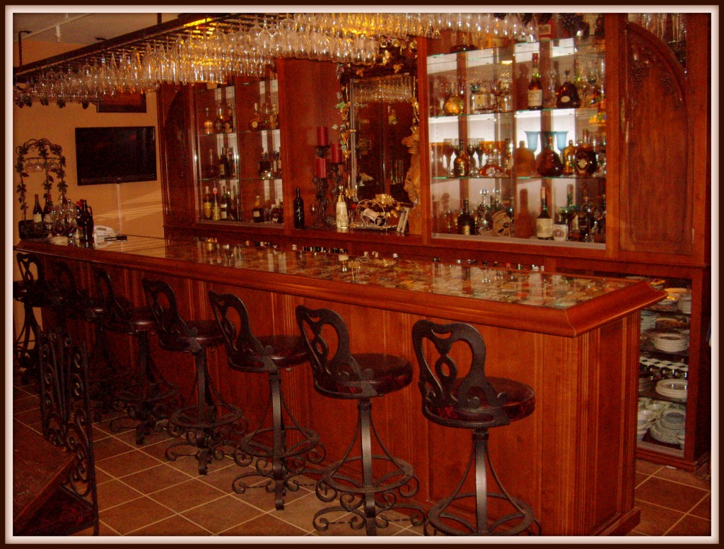 Built In Home Bar With Extensive Liquor And Glass Storage Area
