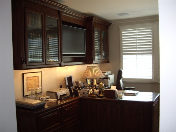 Custom Home Office Design For A Stock Broker With A Built In Tv.
