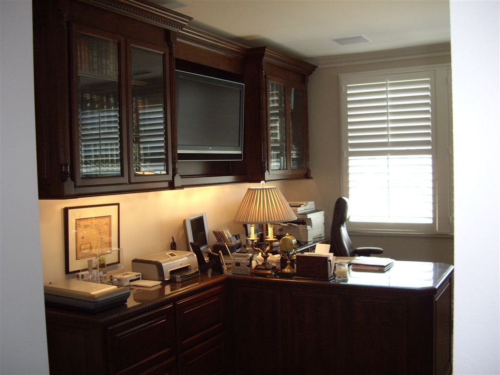 Custom home office design for a stock broker with a built in tv. | C