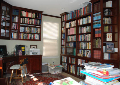 Home Office With Floor To Ceiling Book Shelves