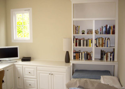 White desk with twin bed