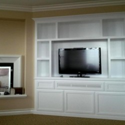 Beautiful after photo. Unit painted in white lacquer over maple. Great quality!
