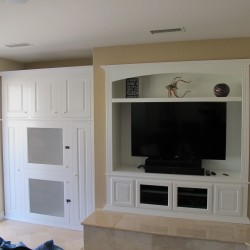 White wall unit with built in dog kennels