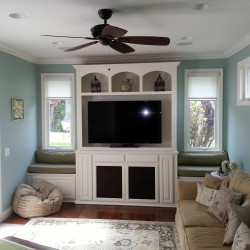 Pretty white wall unit with dual window seats