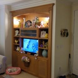 Built in entertainment center cabinet in medium maple finish