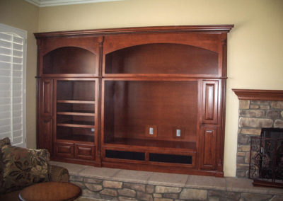 Custom entertainment center cabinet with arches
